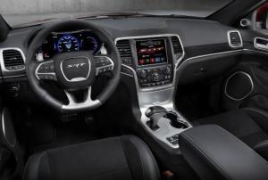 Newly designed interior for the 2014 Jeep Grand Cherokee. (SRT model shown above)